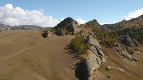 Park Terelj rocks and steppe near Ulaanbaatar Mongolia. Autumn sunny blue sky clouds. Beautiful Mongolian nature.