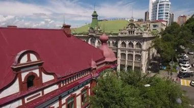 Vladivostok GUM luxurious fantasy historic building. Beautiful old architecture. Best of Russia Tourists shopping moll Kunst and Albers trading house. Day road
