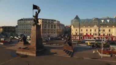 Central main square old buildings. Vladivostok Russia. Large bronze monument. Main streets crossroad Okeanskaya and Svetlanskaya. Tourist sightseeing