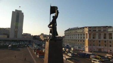Central square Fighters Soviet Power in the Far East. Vladivostok Russia. Main streets crossroad Okeanskaya and Svetlanskaya. Sunset evening traffic jam
