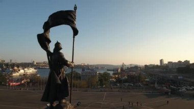 Central square Fighters for Soviet Power in the Far East monument. Vladivostok Russia. Main streets. City panorama people walk.