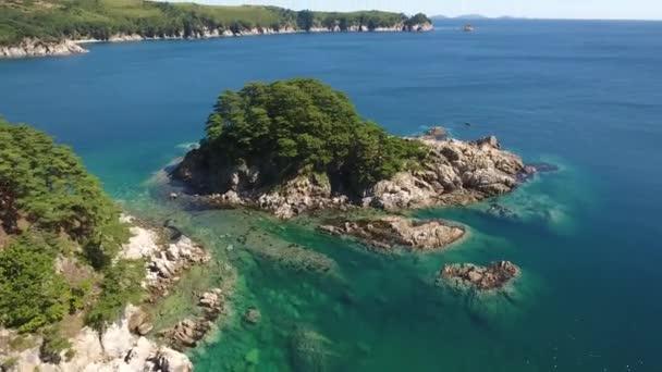Island Languishing Heart blue water. Far East Marine Biosphere Reserve Primorsky Krai Vladivostok Russia. Unique National park Japan Sea ocean.