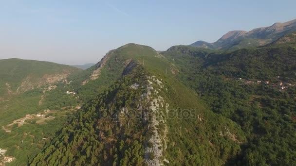 Mountains nature Montenegro old village. Green forest hills. Blue sky. Beautiful vista. Summer