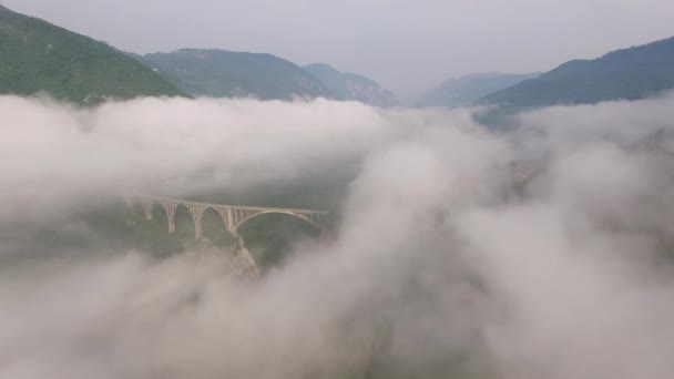 Epic Morning fog clouds. Tara river canyon mountains. Best of Montenegro beautiful nature Europe sightseeings. Helicopter approach to Concrete arch bridge.