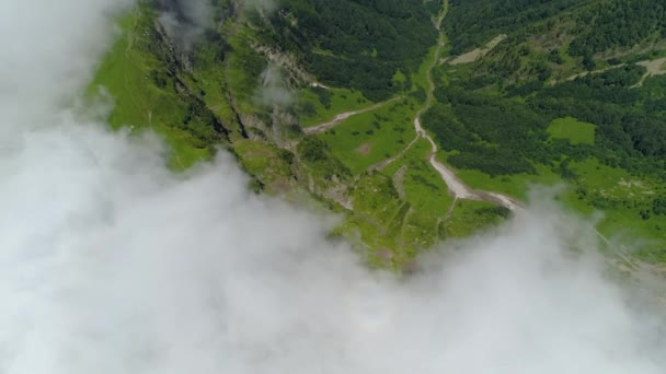 From high altitude mountains through fog clouds natural countryside unique nature landscape mountain river rocky slopes. Sochi best Russia famous alpine ski village resort. Green forest. Summer sunny