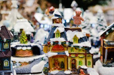 Decorated Christmas children shopping toys on joyful festive shiny blurred light background, closeup image. Seasonal elegant natural classy mood, love peace jolly decor design, traditional bright joy