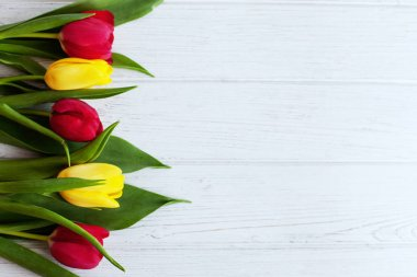 Wooden background with fresh tulips. Conception holiday, March 8