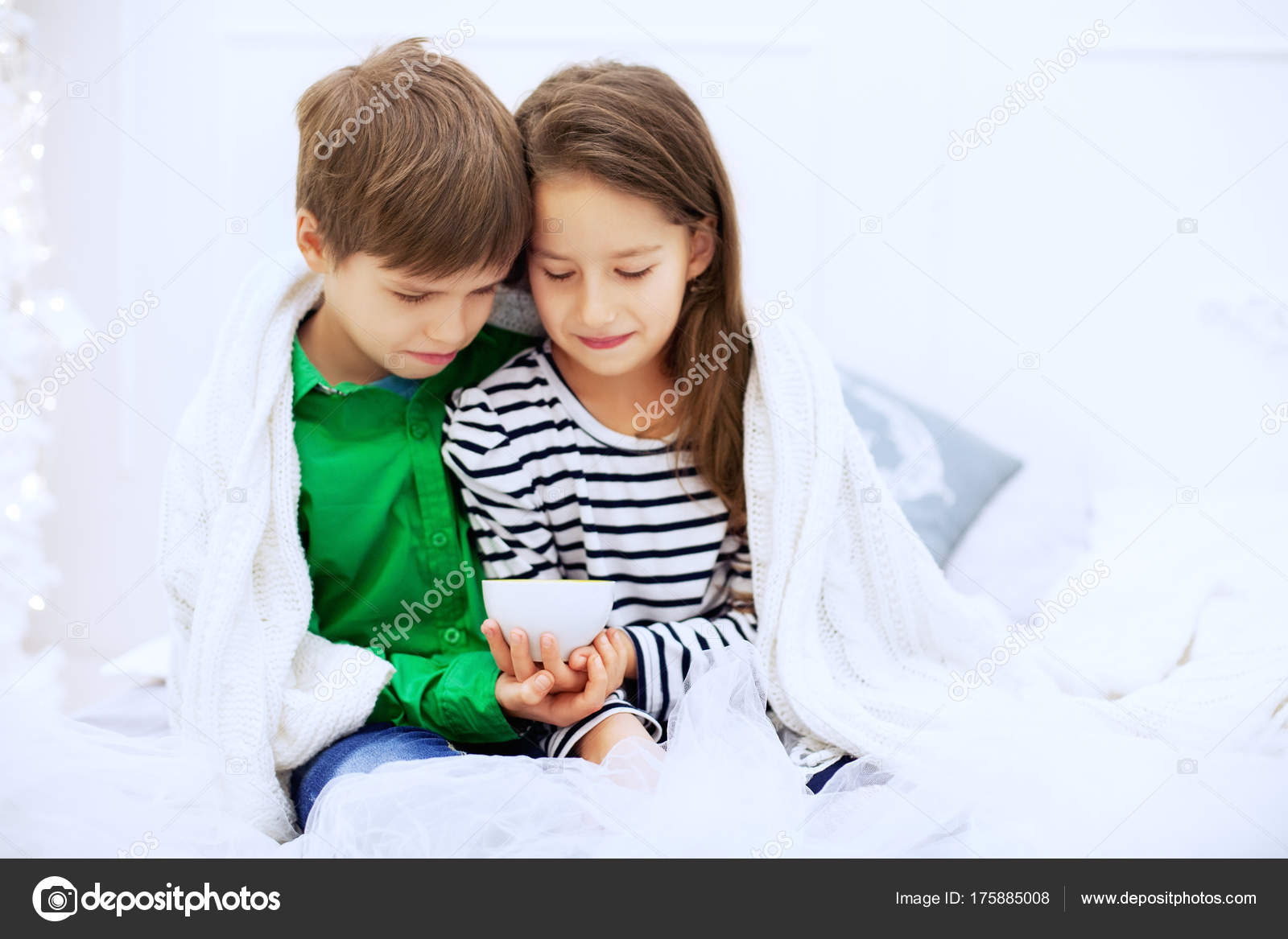 the little boy and girl hugging and drinking tea stock photo