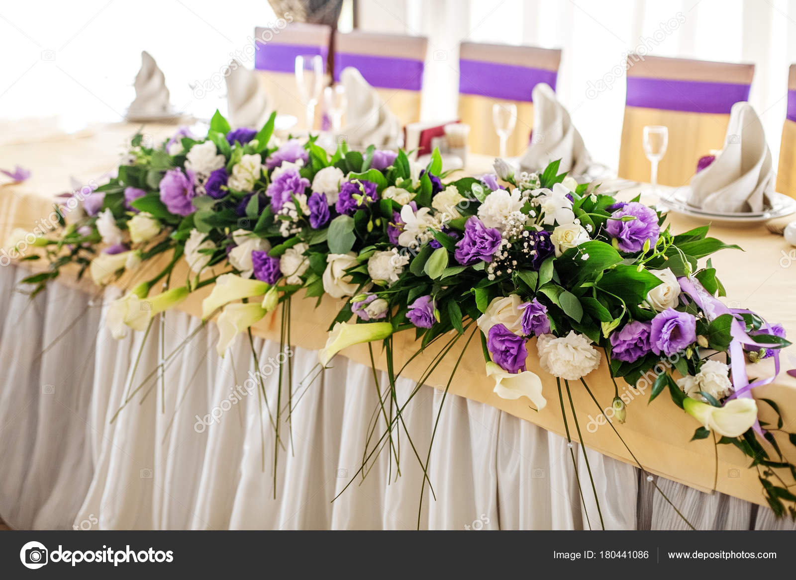 Flower Arrangement On The Table Purple And White Flowers Stock