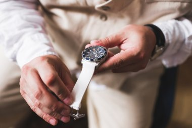 Groom tries on a new watches