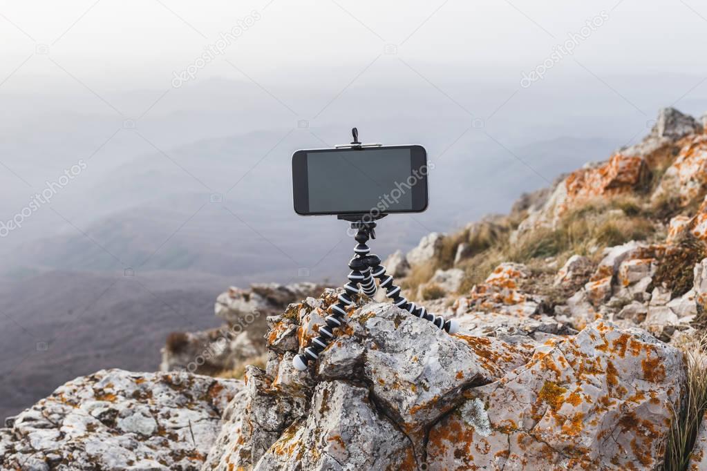 mobile phone with mini tripod