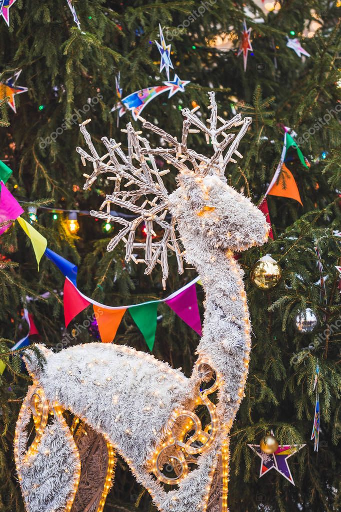 Decorated and illuminated toy reindeer
