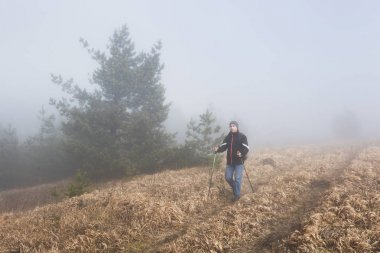 Man hiking with trekking poles