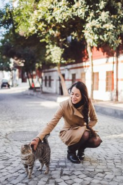 cute girl stroking a cat