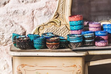 Stack of handmade multicolor Turkish dishes