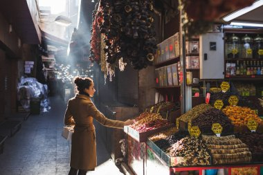 Woman chooses in the market nuts