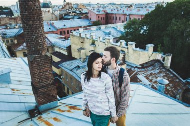 couple walking on the roofs of St. Petersburg.