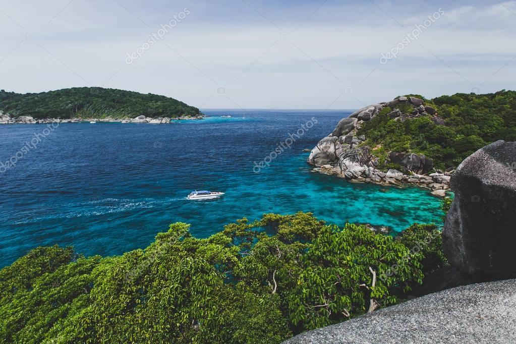 Touristic speedboat near island shore