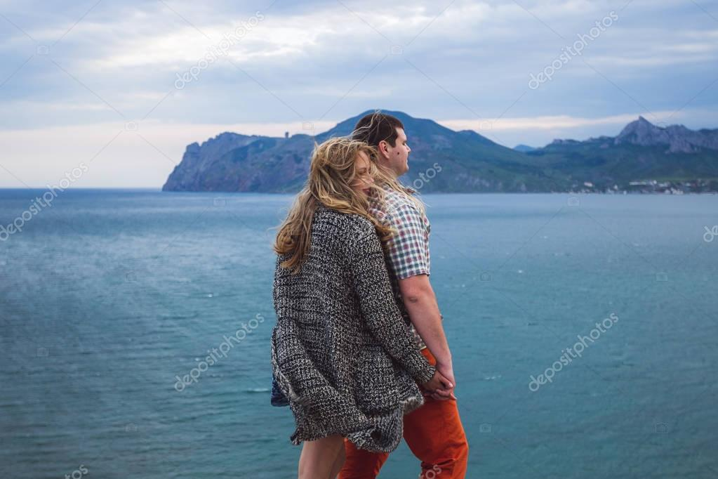 Couple on edge of cliff