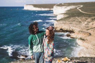 Copuple walking along the coast