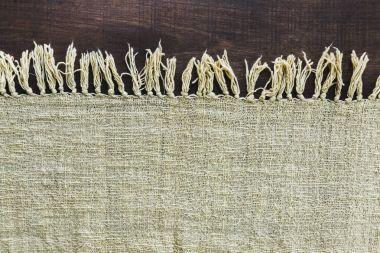 Beige carpet with fringe