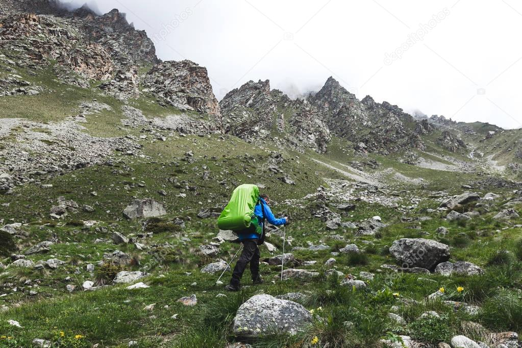Tourist with large backpack hiking