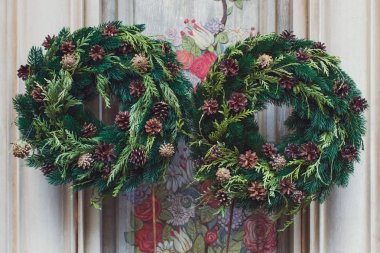 Facade decoration with christmas wreaths with fir branches and c