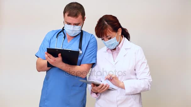 doctor with stethoscope advises nurse in hospital with Tablet