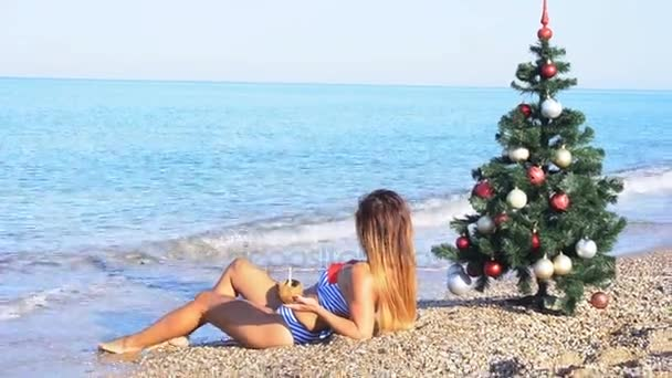6019d59c9a Girl resting on the beach in the resort of Christmas new year– stock footage