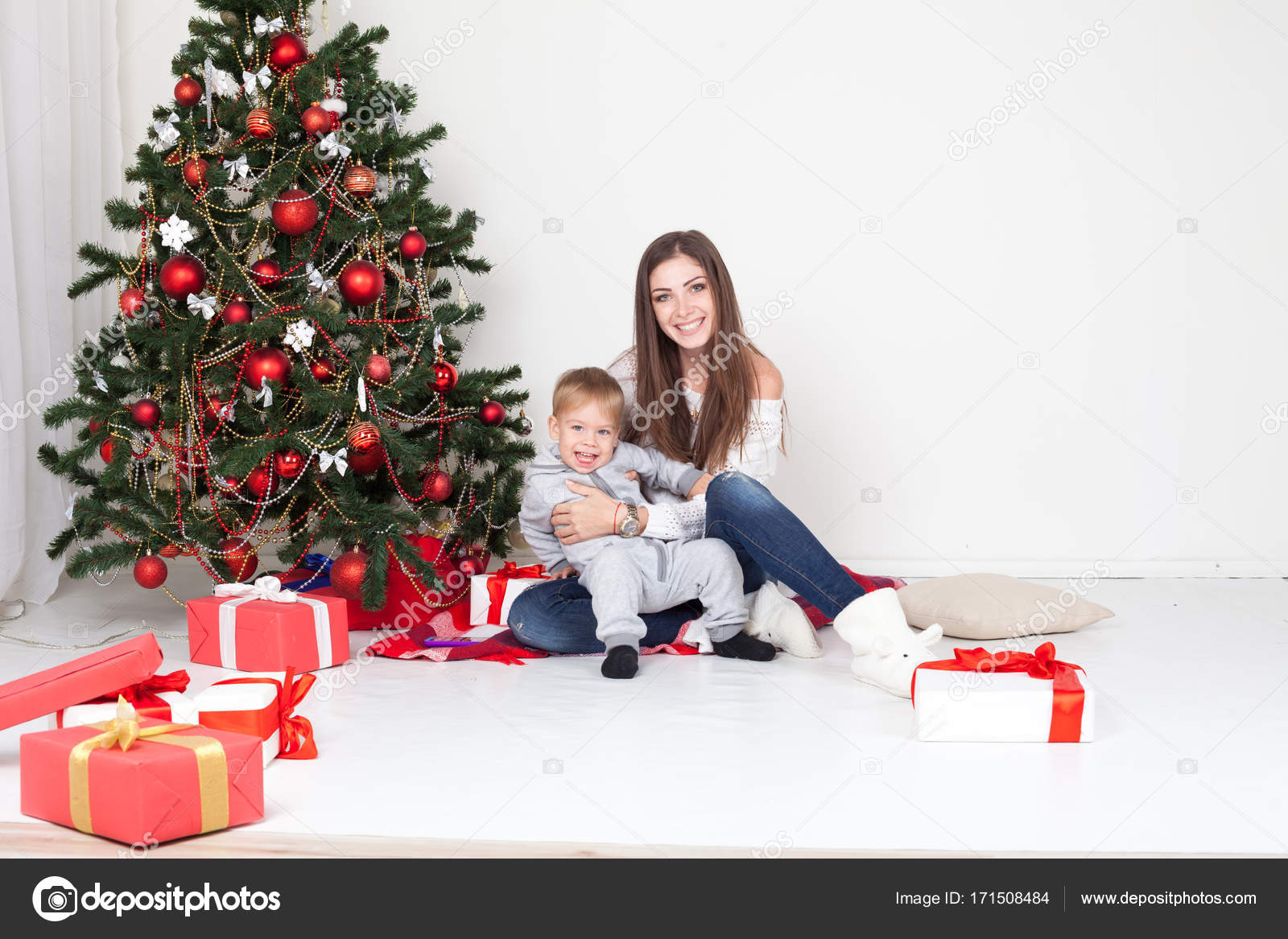 mother and son open gifts on Christmas and new year — Stock Photo ...