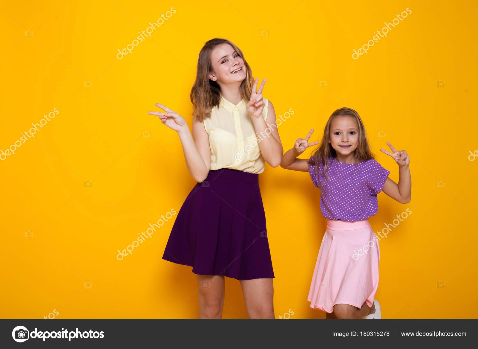 Two Girls In Colored Dresses Laugh Show Fingers 1 Photo By Dsimakov Fotomailru