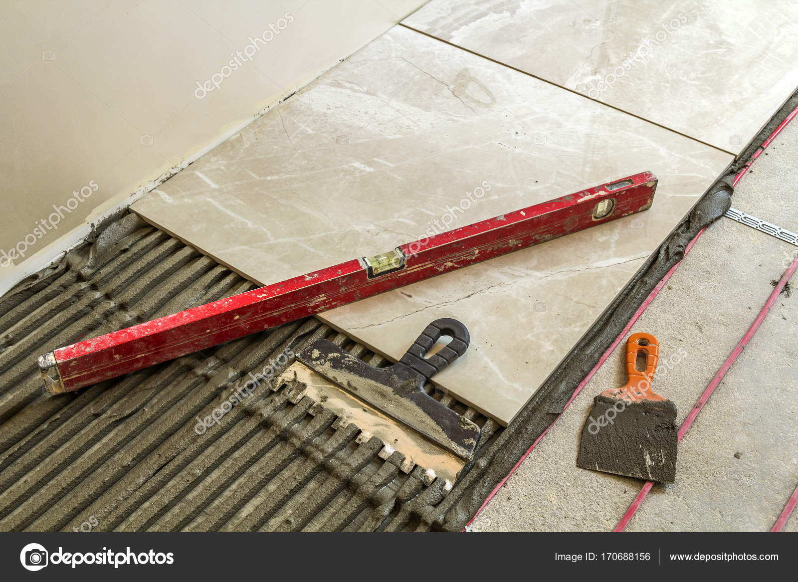Ceramic tiles and tools for tiler floor tiles installation hom ceramic tiles and tools for tiler floor tiles installation home improvement renovation ceramic tile floor adhesive mortar level photo by bilanoli dailygadgetfo Image collections