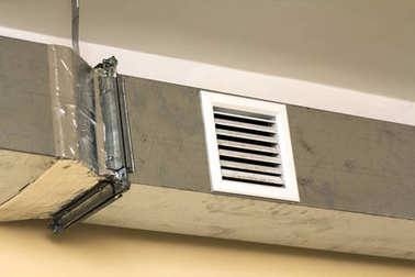 Ventilation pipes in silver insulation material hanging from the