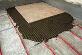 Nástroje pro pokrývačské a keramické dlaždice. Dlažba instalace. Hom