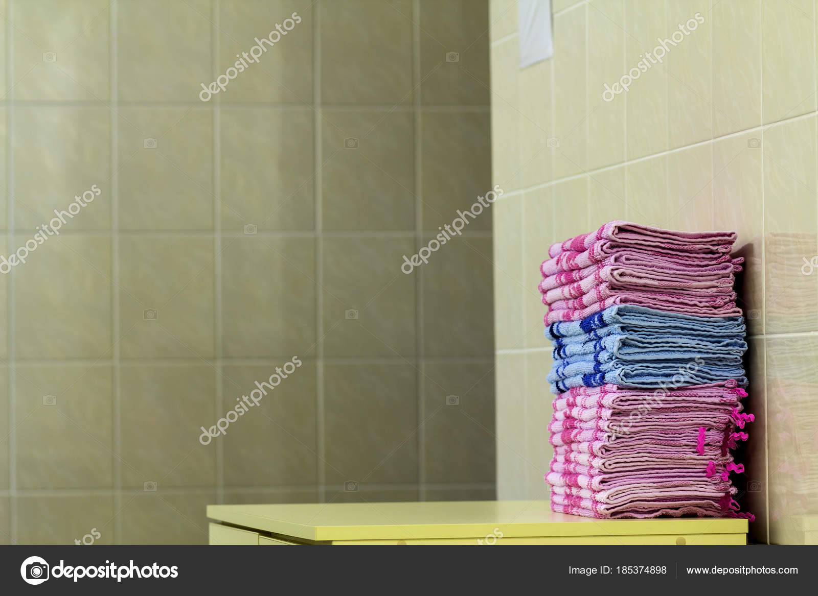 stack of pink bath towels close up with blurred background stock photo - Pink Bathroom Towels