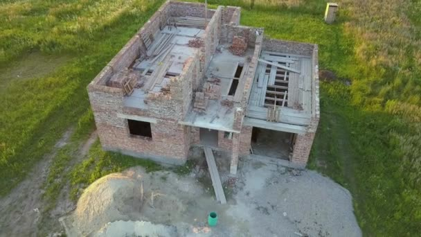 Aerial view od new brick unfinished house under construction.