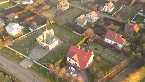 Aerial landscape of small town or village with rows of residential homes and green trees.