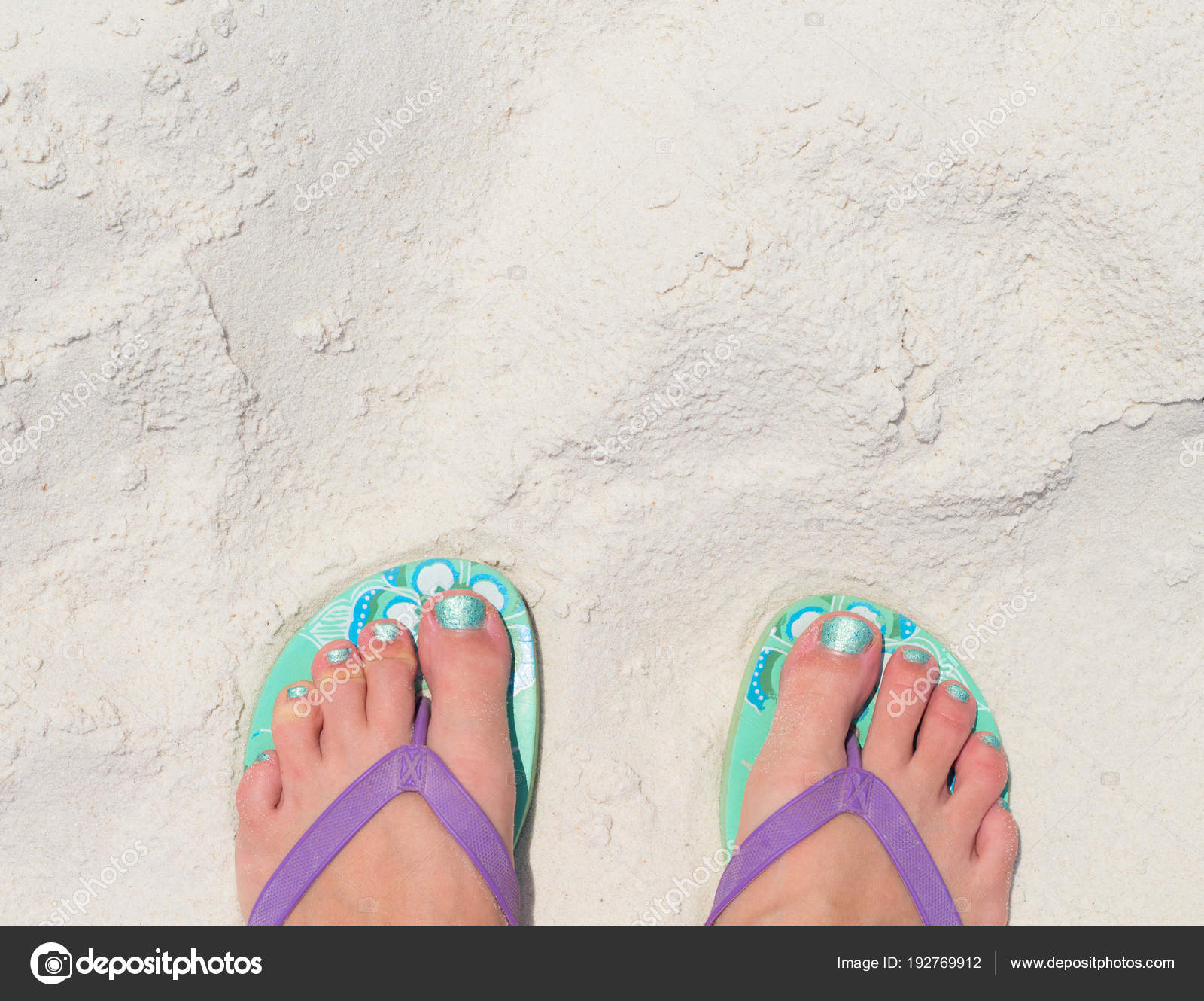f3390bb255a57 Woman feet in slippers on beach. Young woman tourist by sea. Seaside banner  template