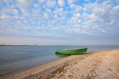 Small boat on the beach. Wide angle.