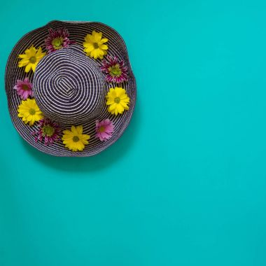 Beach blue hat decorated with flowers