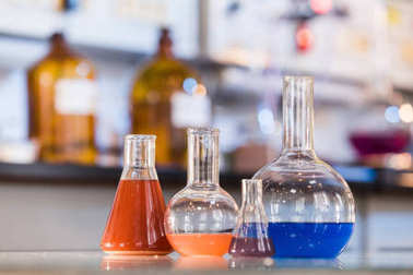 Beaker with colorful liquid in the laboratory