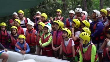 ANTALYA - TURKEY - MAY 2017: Briefing to kids about water rafting on the rapids of river Koprucay at Koprulu Canyon, Turkey. Koprucay River is the most popular for rafters in Turkey