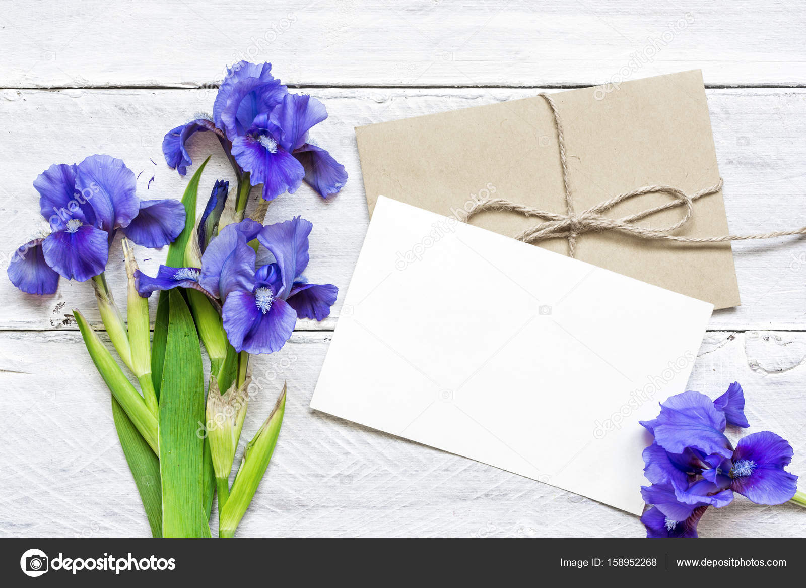 Blank white greeting card with blue iris flowers bouquet and blank white greeting card with blue iris flowers bouquet and envelope on white wooden background top view mock up photo by samael334ail izmirmasajfo