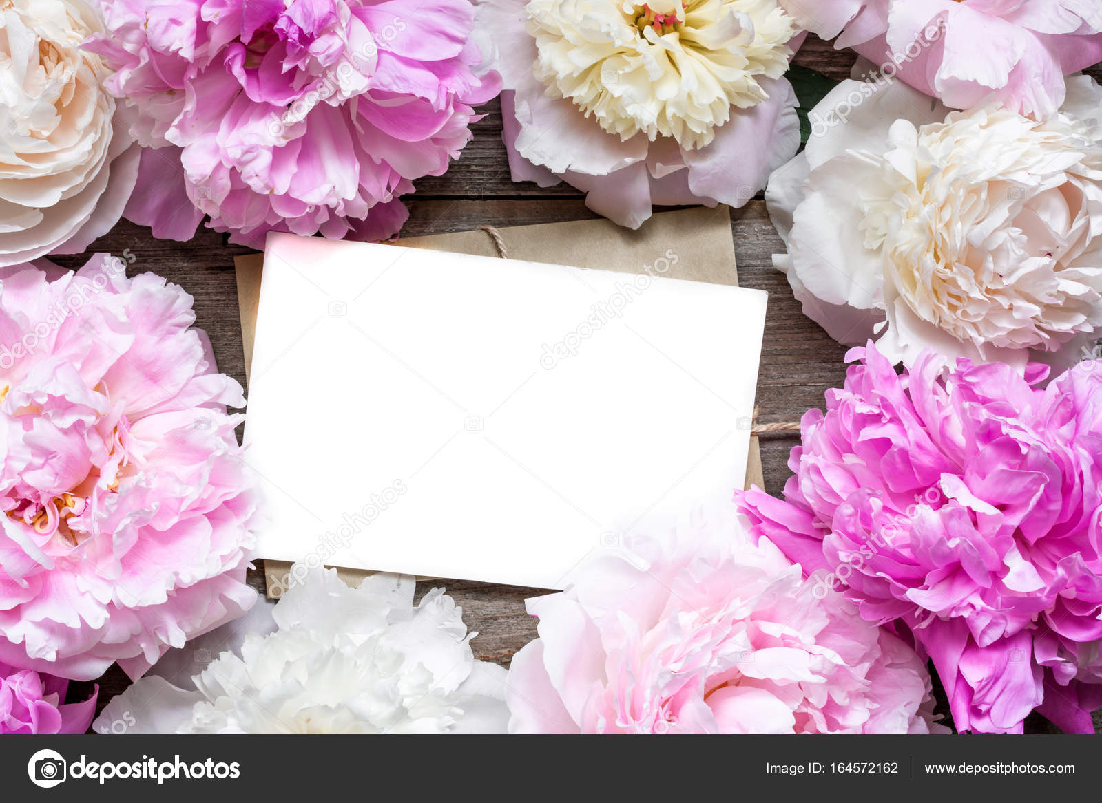 blank greeting card or wedding invitation and envelope in frame of ...