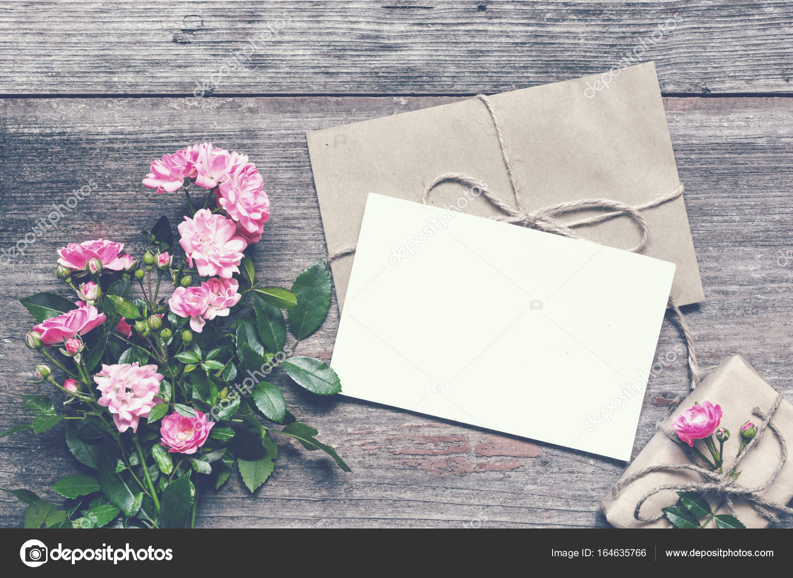 Blank white greeting card with pink rose flowers bouquet and blank white greeting card with pink rose flowers bouquet and envelope with gift box on rustic wooden background vintage toning p view mock up photo m4hsunfo