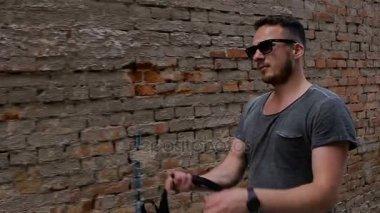 A tourist walks along an alley near a brick wall. Slo-mo shoot