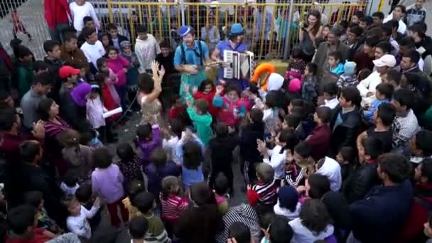 Refugees, Lesvos, Greece. November 2015. Clowns performs for refugees.