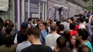 RUSSIA, MOSCOW - JUNE 12, 2017: Rally Against Corruption Organized by Navalny on Tverskaya Street. The police removes the detainee from the crowd, people shout: Shame