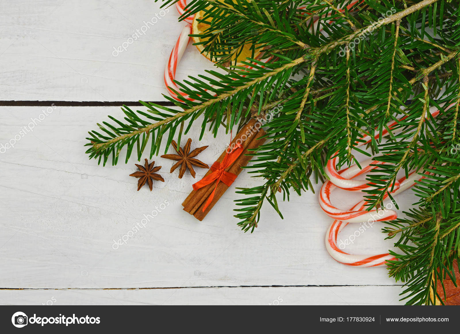 christmas holiday background with gingerbread cookies candy cane and evergreens border over wooden table christmas and new year food