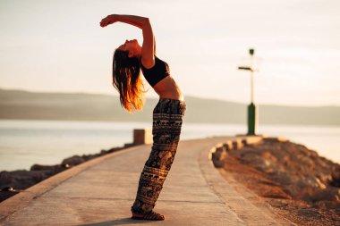 Carefree woman meditating in nature.Finding inner peace.Yoga practice.Spiritual healing lifestyle.Enjoying peace,anti-stress therapy,mindfulness meditation.Positive energy.Upward salute back bend pose